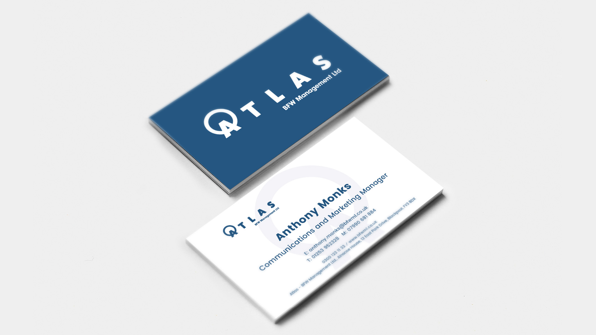 Atlas Management branding shown on business cards
