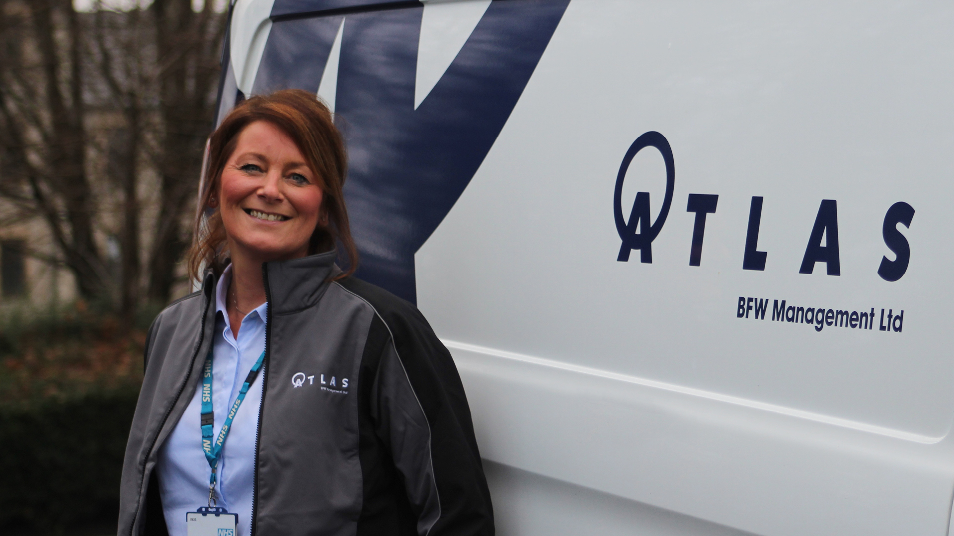 Atlas Management branding shown on vans